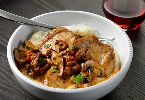 Chicken with Wild Mushrooms, Tomatoes, and Capers over Creamy Garlic Grits